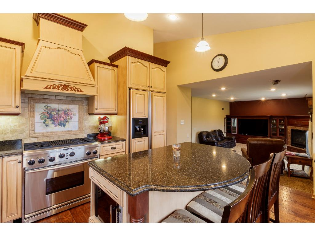 Beautiful built-in cabinetry with gas fireplace in spacious family room.  Great sight lines into kitchen.