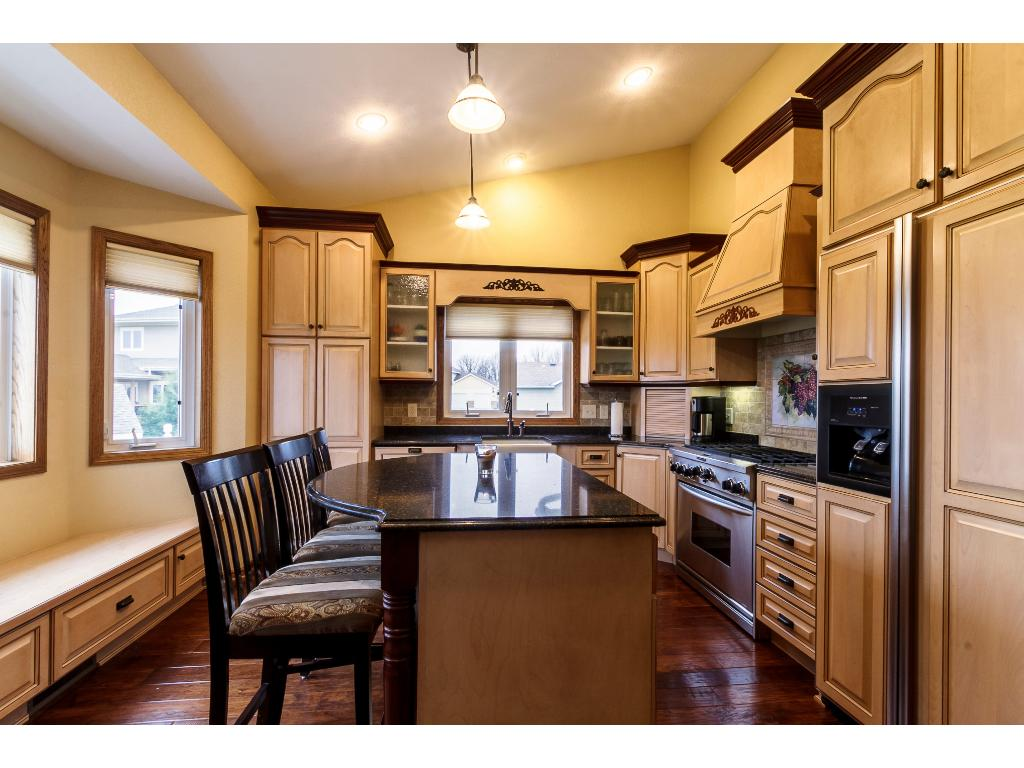 Breakfast bar offers eat-in kitchen option or seating to visit with guests with plenty of room for food prep.  Check out the gorgeous views from the large kitchen windows!