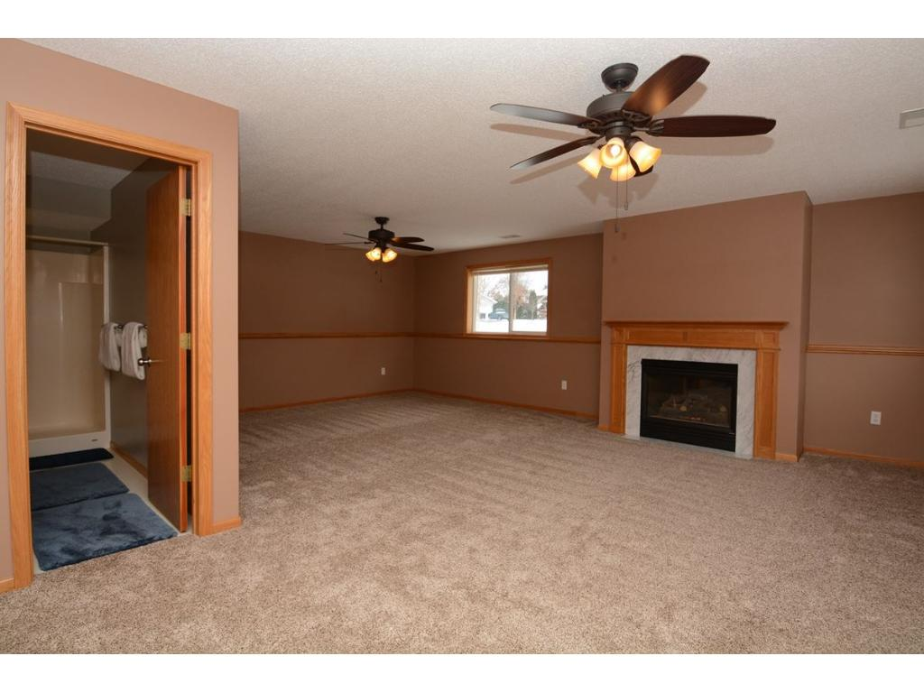 Lower level living room with cozy fireplace.