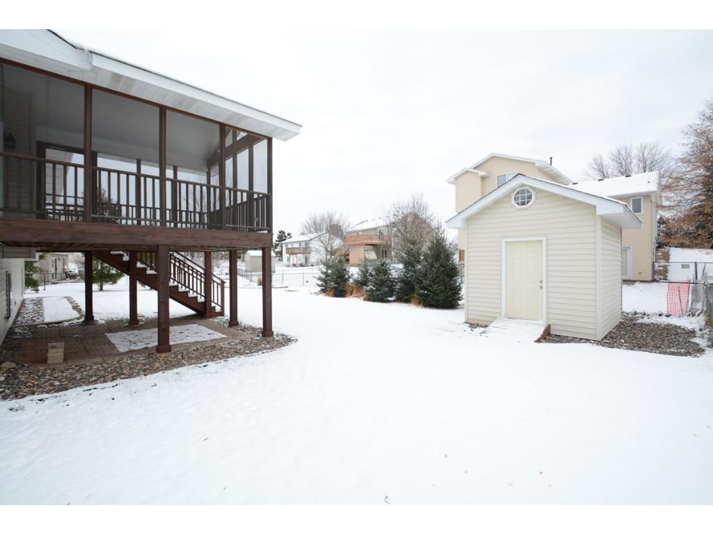 Amazing backyard with beautiful three season porch and storage shed.