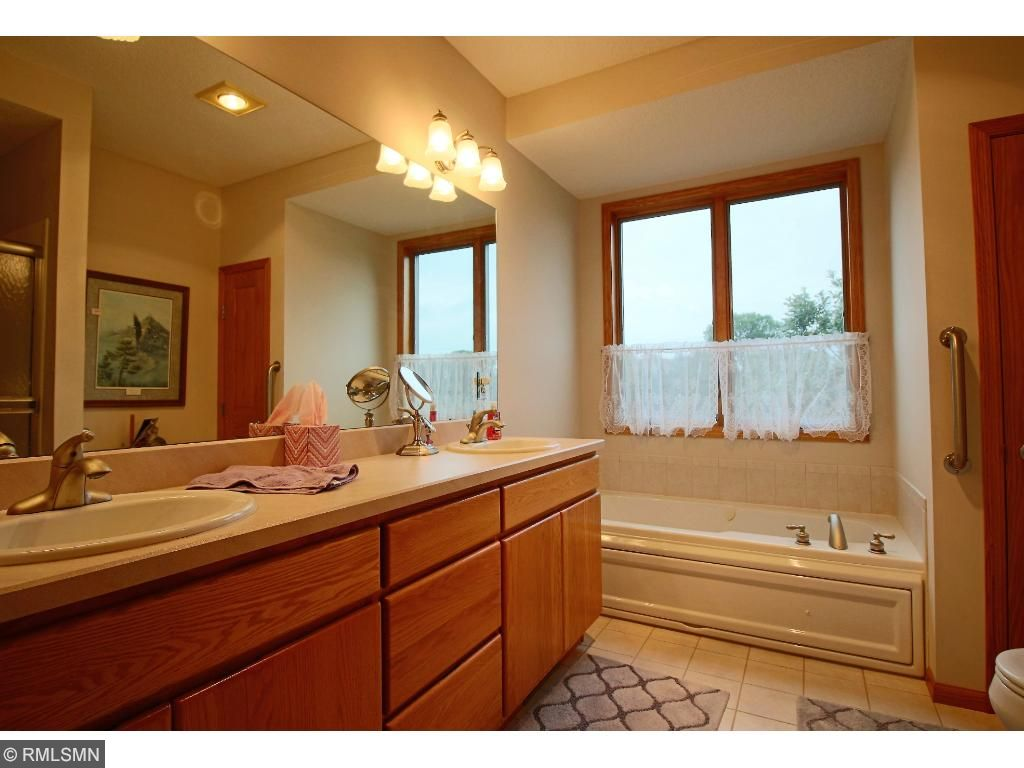 Private Master Bath with Separate Tub and Shower and with his and her sinks