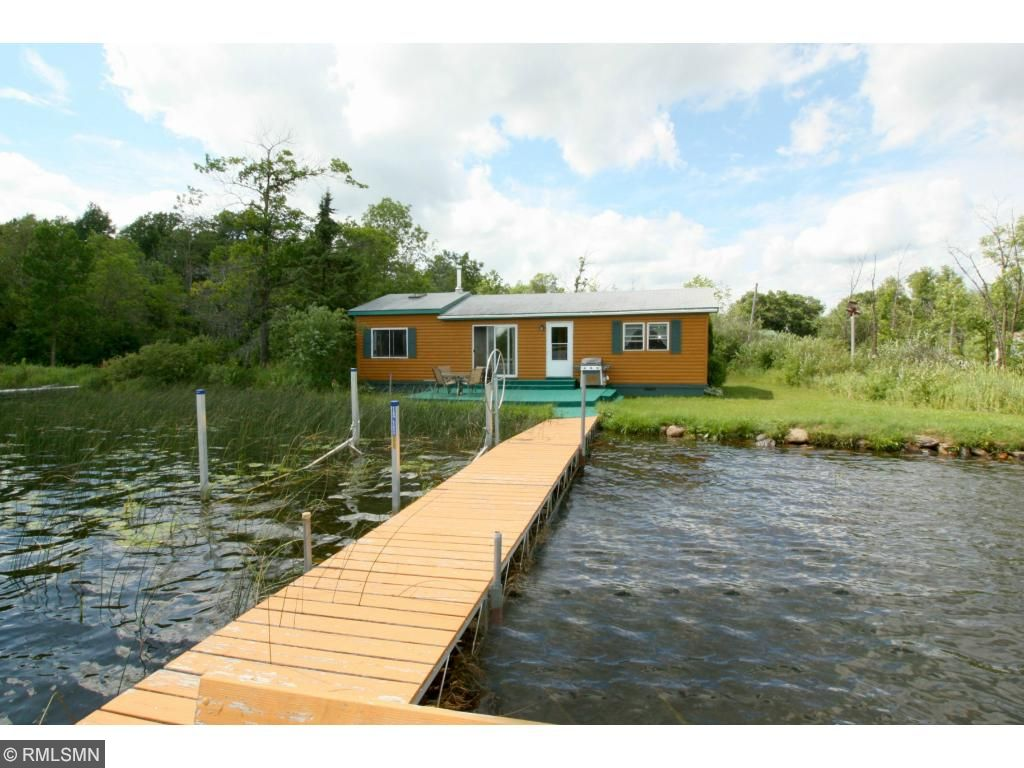 Ready for your summertime activities!  Two bedroom seasonal cabin with 1/2 log siding.