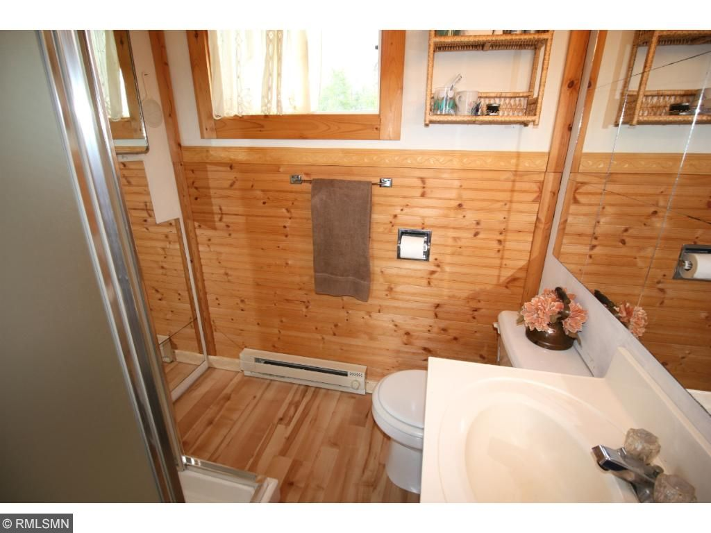 The 3/4 bath has been remodeled with knotty pine interior and brand new shower.