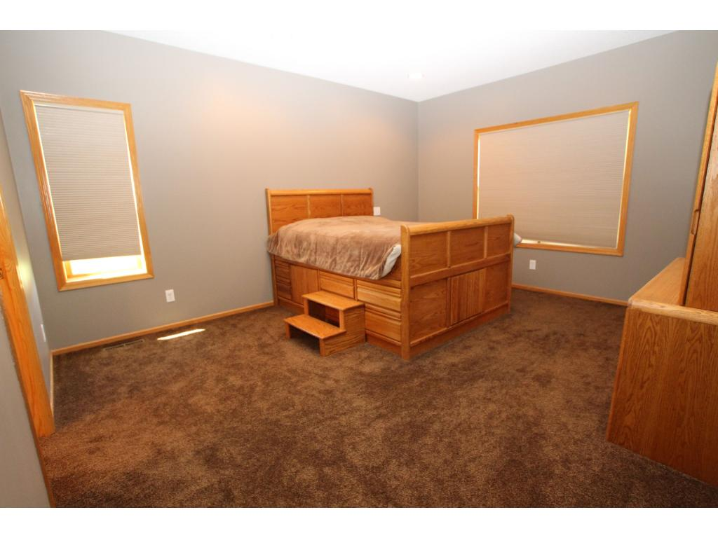 The master suite is located on one end of the home with the other two bedrooms located on the opposite end.