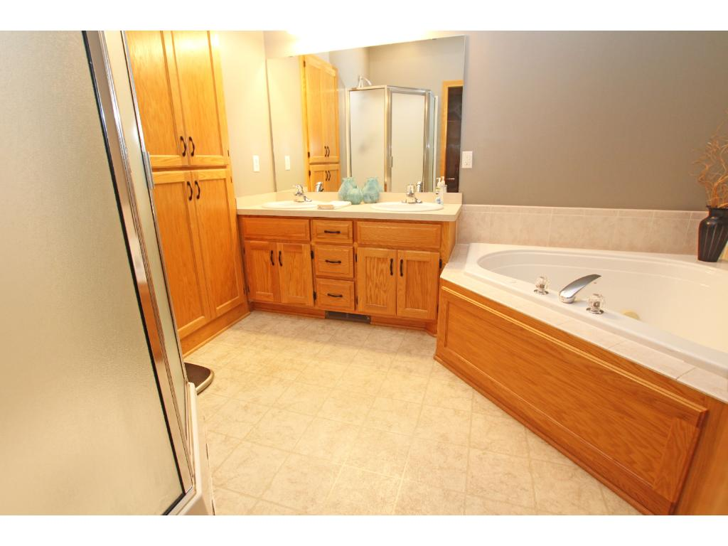 The master bathroom features a corner whirlpool tub and a separate shower.  There is also a nice walk-in closet for the master bedroom.