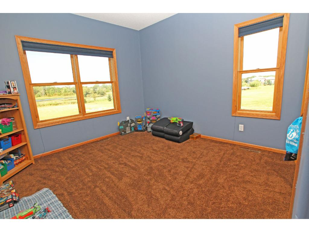 The third main floor bedroom which has two nice windows out to the back and side yards.
