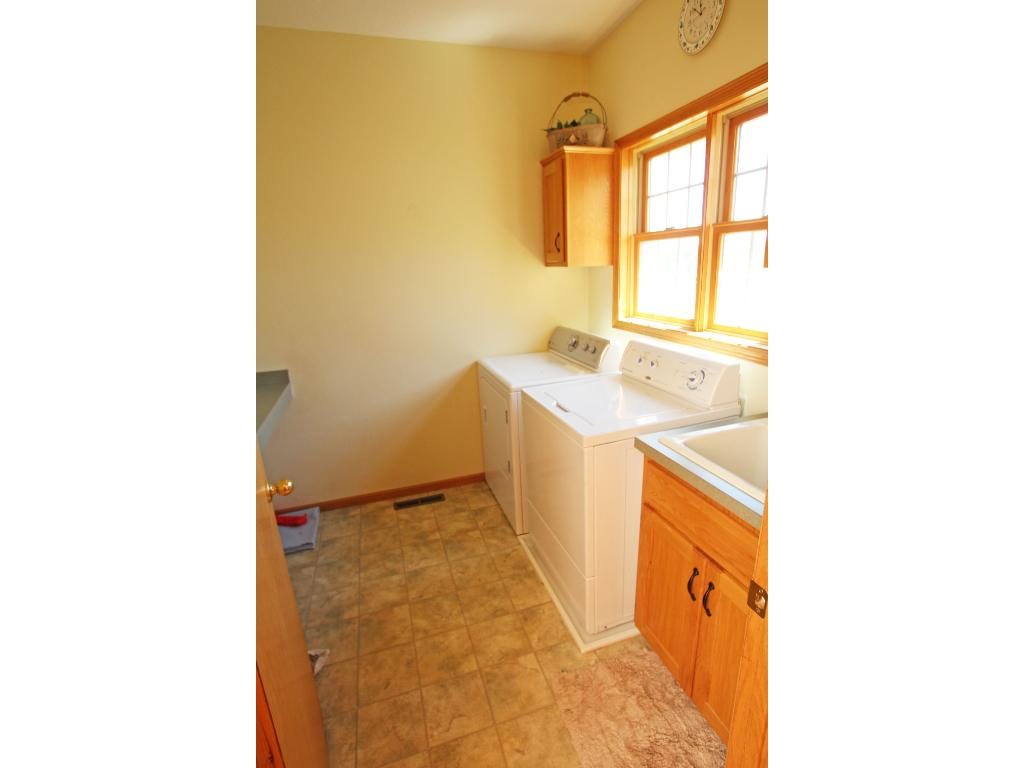 Main floor laundry is located just off the of the garage (3-car attached, insulated) and has a convenient folding counter as well.