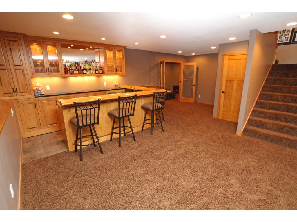 Just beyond the wet bar area is the home theater room.