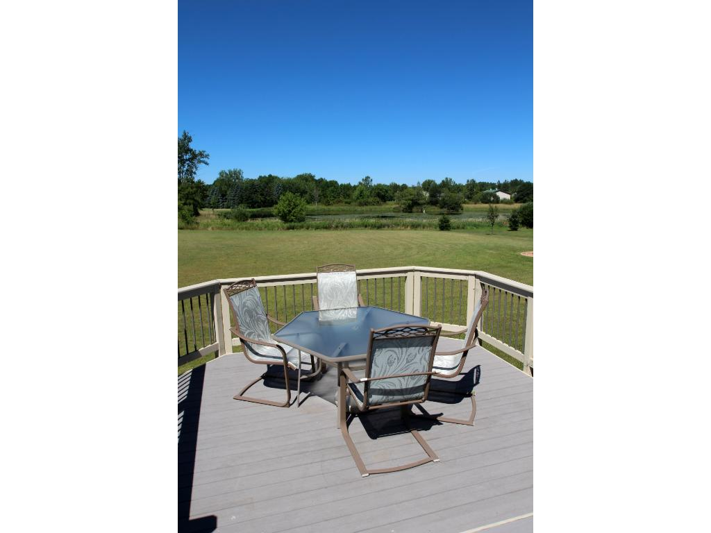 Enjoy a summer barbecue on the backyard 2-tiered deck.