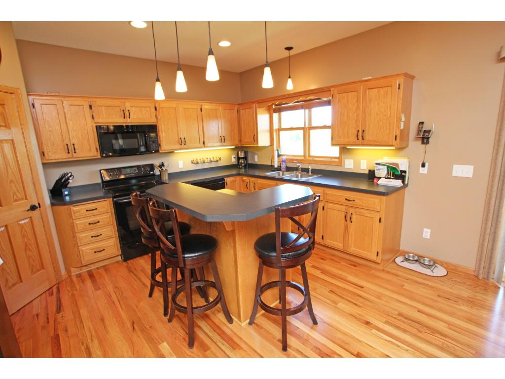 The kitchen has a convenient center island with additional seating area.