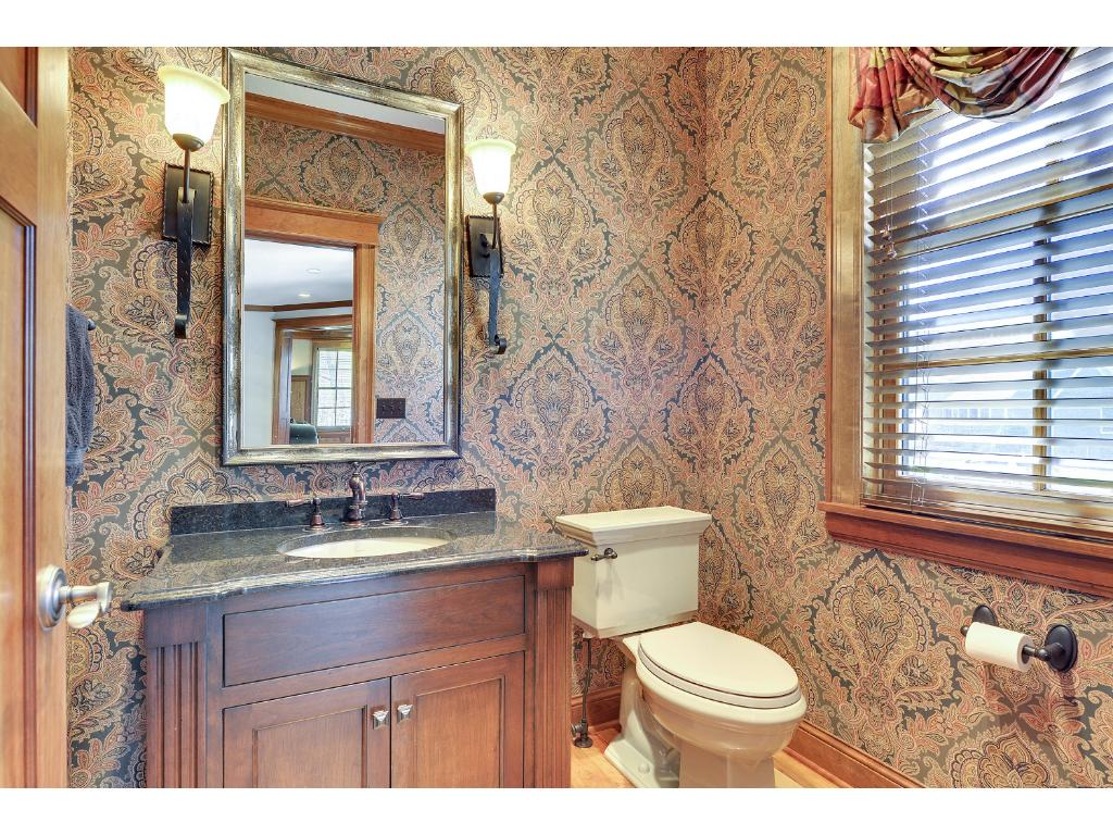 Even the Powder Room is beautifully finished, with furniture-style vanity.