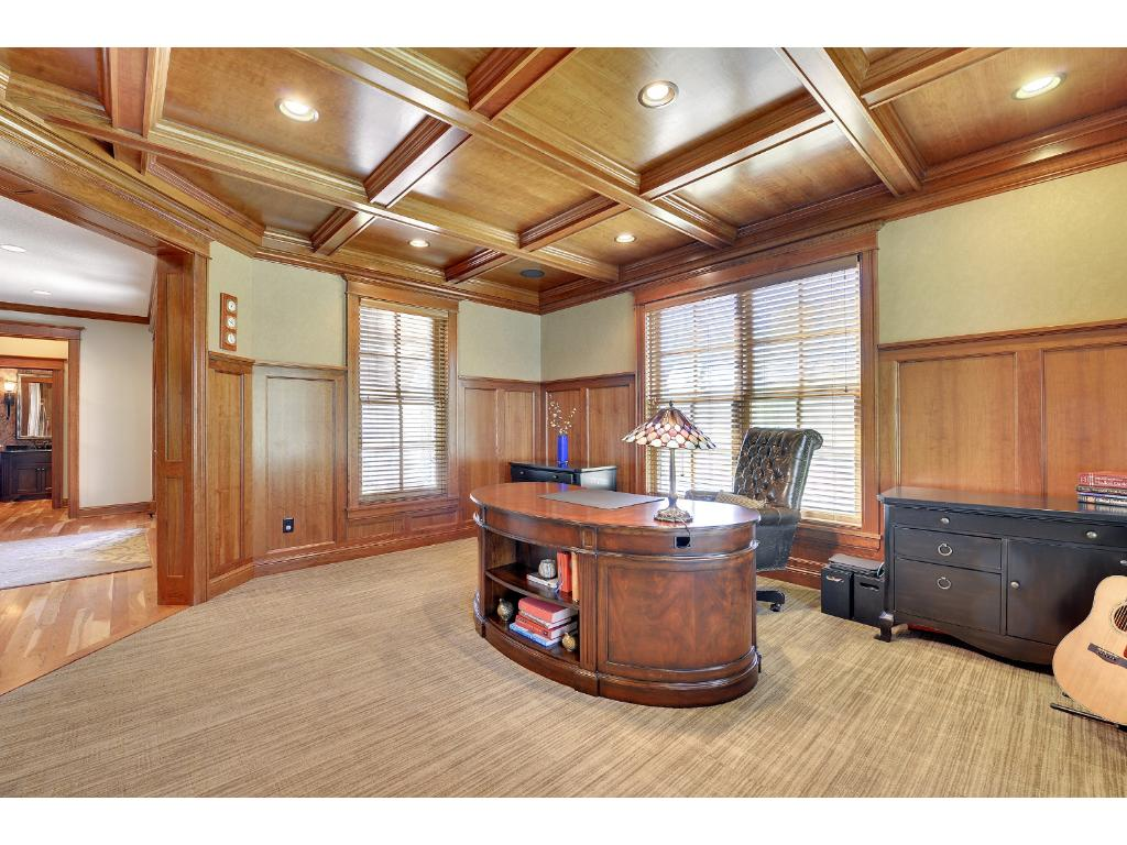 The Executive Home Office features gorgeous millwork with wainscoting and a box-beam ceiling.