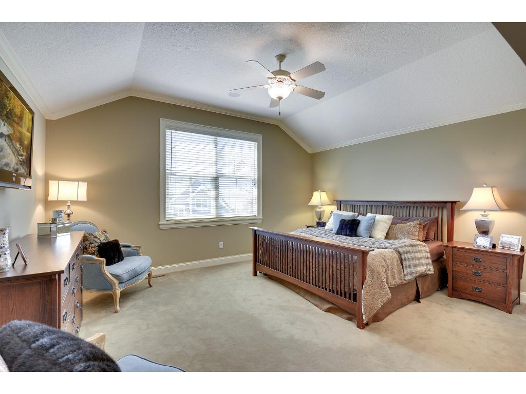 The Master Suite offers a vaulted ceiling and is a private, serene retreat.