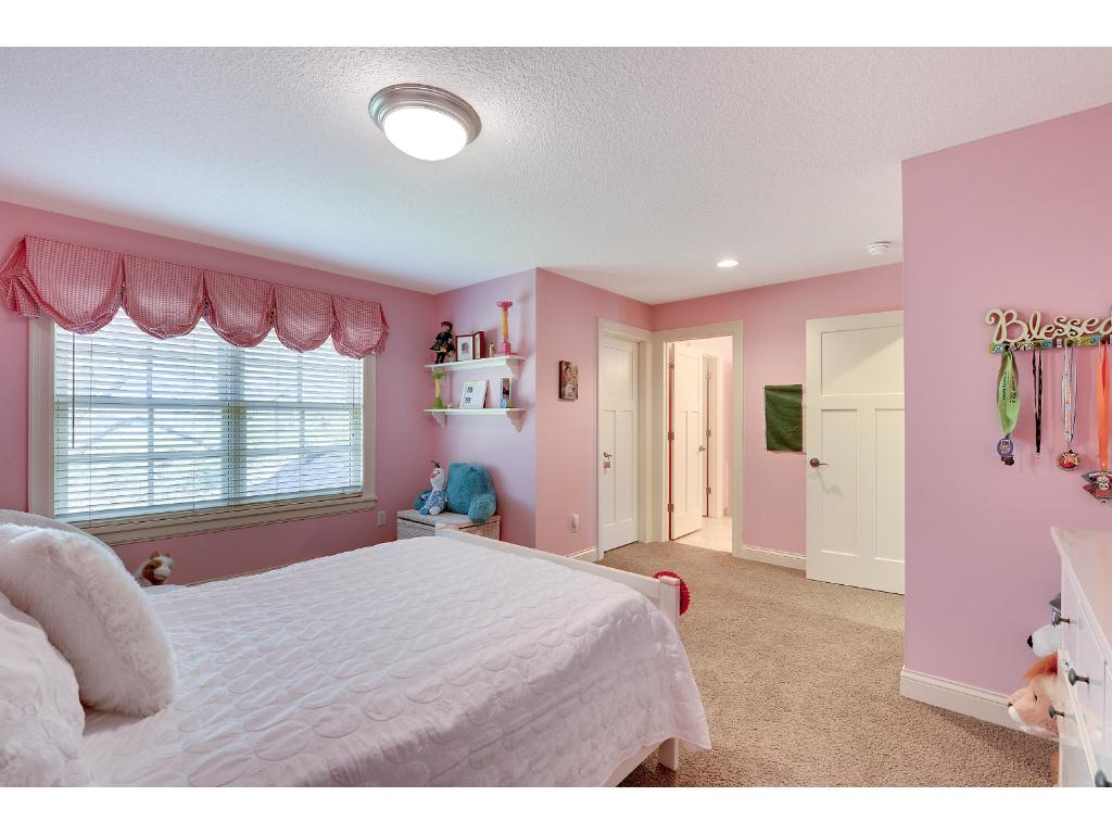 Spacious Bedrooms share a Jack and Jill Bath and have large Walk-in Closets.