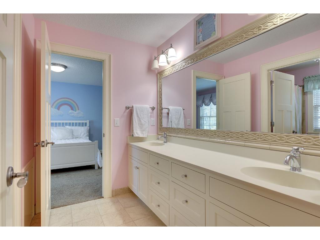 The Jack and Jill Bath has tiled floors, a double Vanity, and Linen closet.