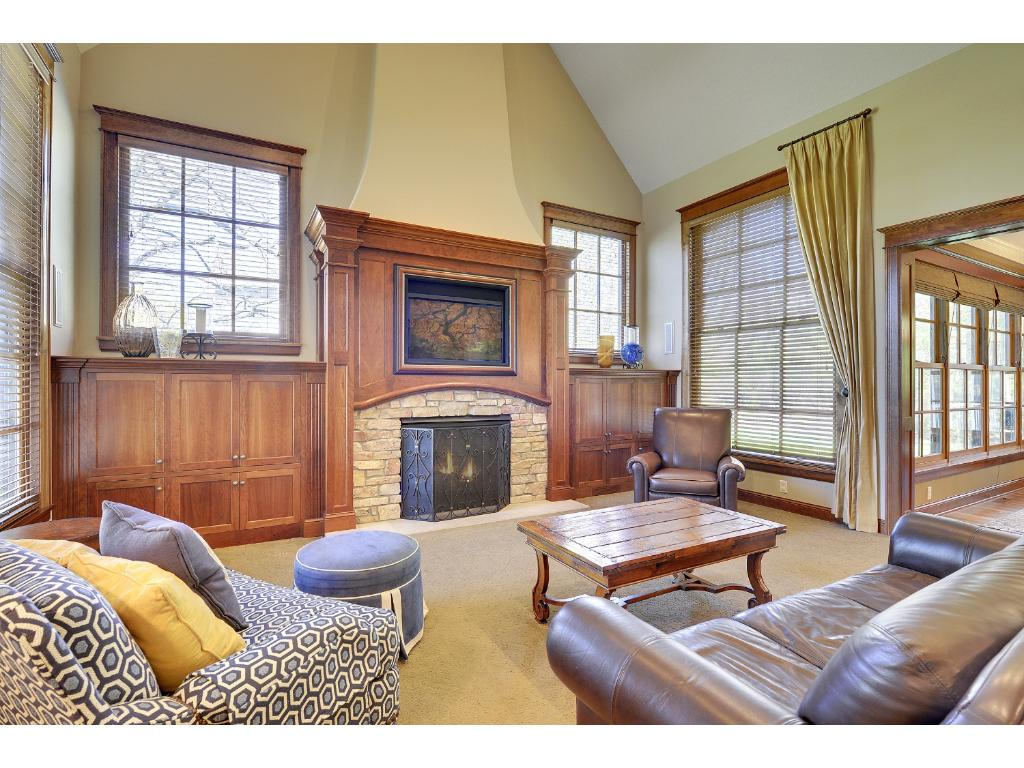 The vaulted Family Room features a Gas Fireplace and custom built-in entertainment center.
