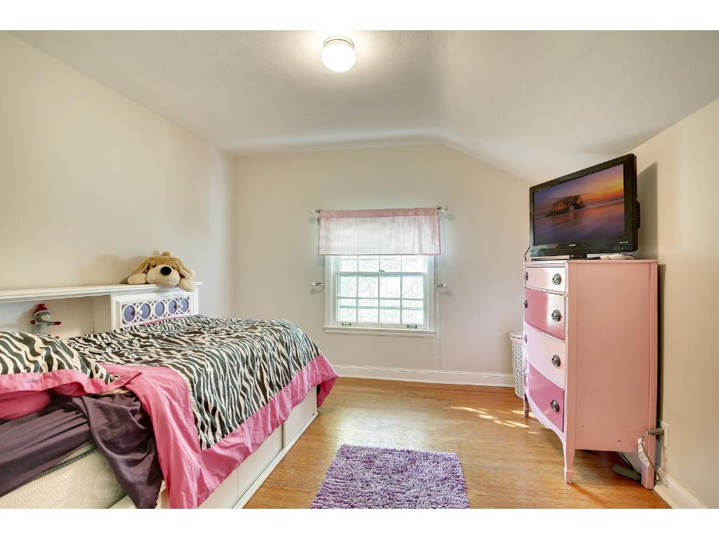 This Bedroom boasts of hardwood floors and is conveniently located just steps from the full bath.