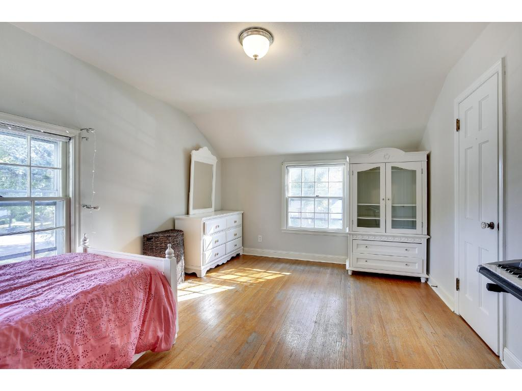 This Bedroom boasts of hardwood floors, gorgeous natural lighting during the day, wonderful space, and is conveniently located just steps from the full bath.