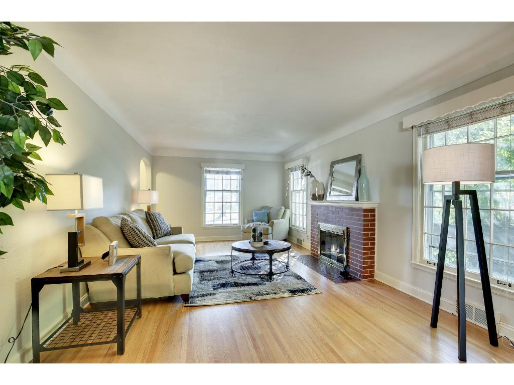The main level welcomes you in with gleaming hardwood floors and sun-filled rooms.