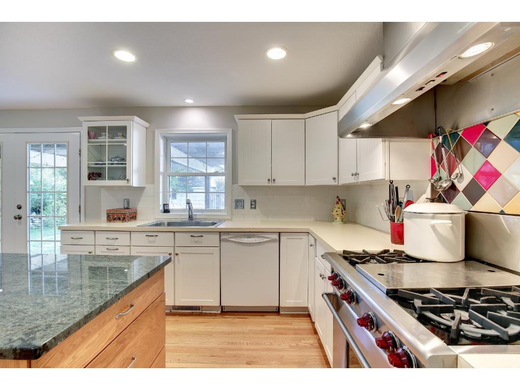 Enjoy beautiful views of the yard from this charming Kitchen. You will also find convenient access to the backyard deck.