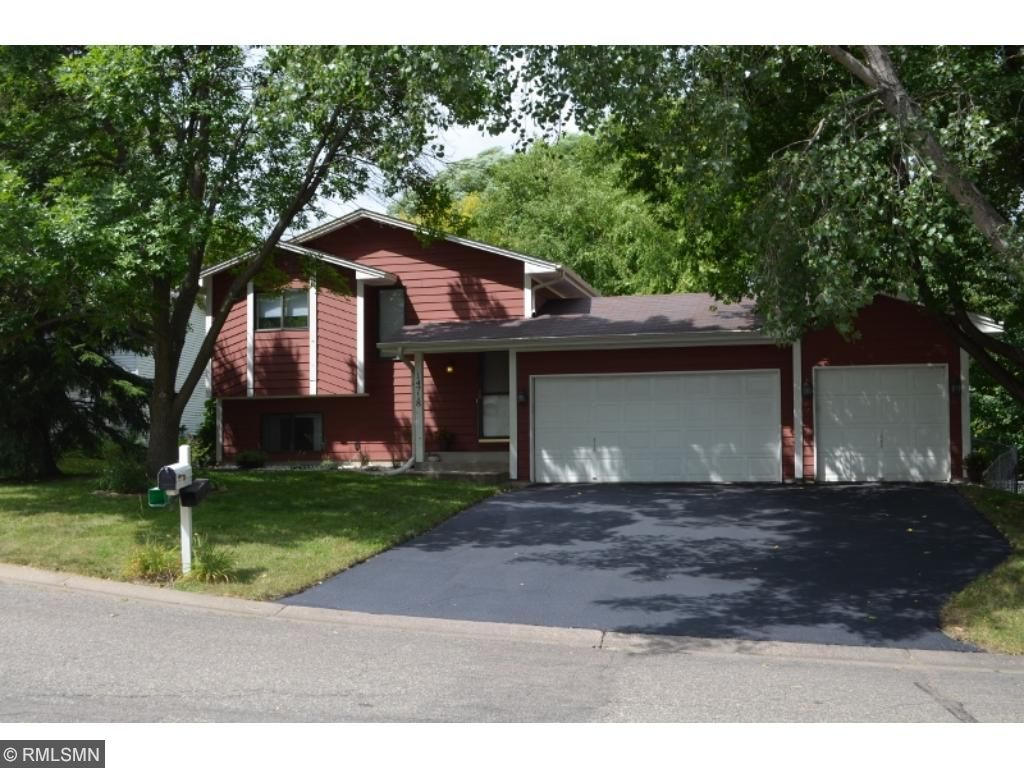 A serene, private cul de sac welcomes you to this well cared for split entry