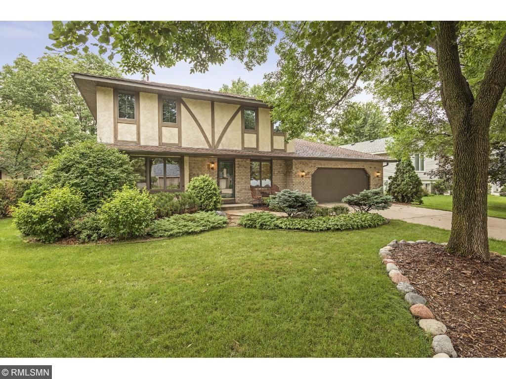 Welcome home to this inviting two story home on a quiet, tree lined street!
