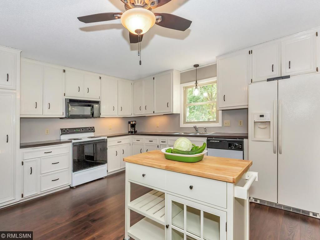 Open Kitchen Features All New Wood Flooring. Lots Of Cabinets And Counter  Space.