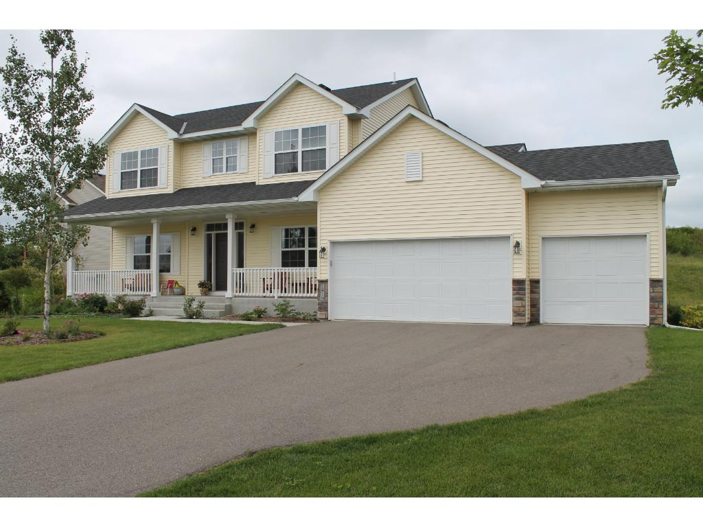 Welcome Home....it all starts with great curb appeal on this wonderful home with picture perfect front porch!
