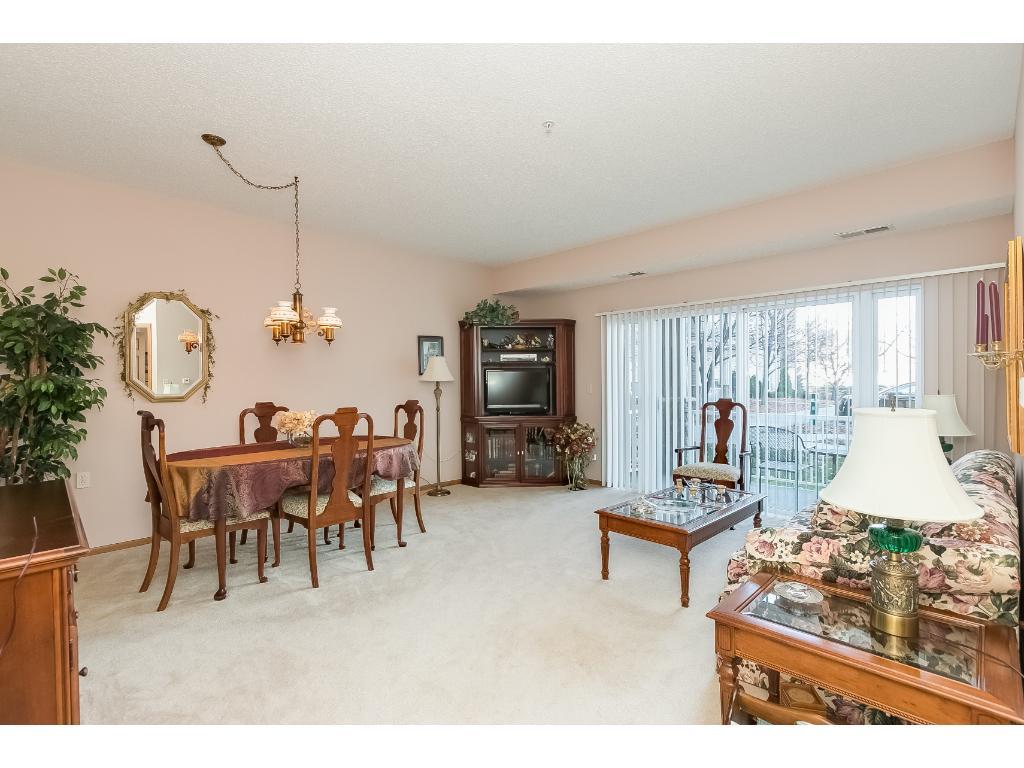 Plenty of room for a full size dining table and living room furniture.