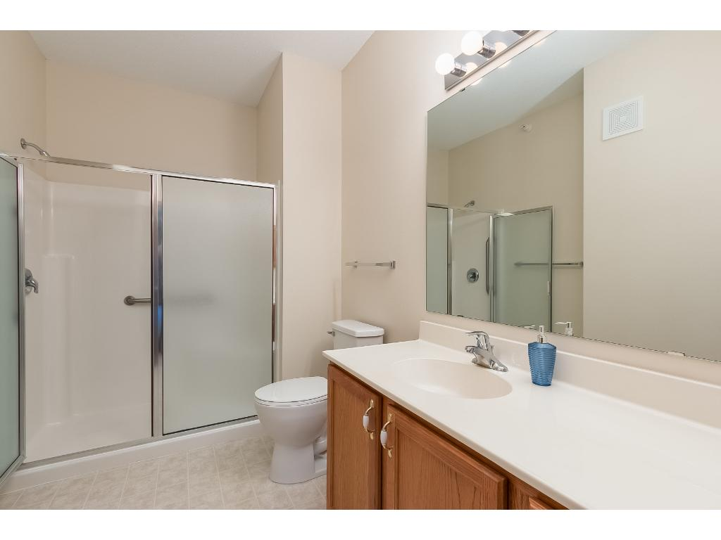 The master bath has a 5 foot walk in shower with two seats and grab bars.