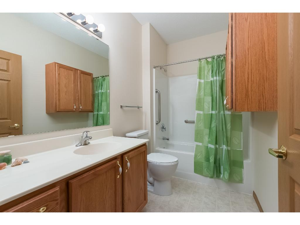 The 2nd bathroom has a standard 5 foot bathtub and an additional storage unit on the side wall.