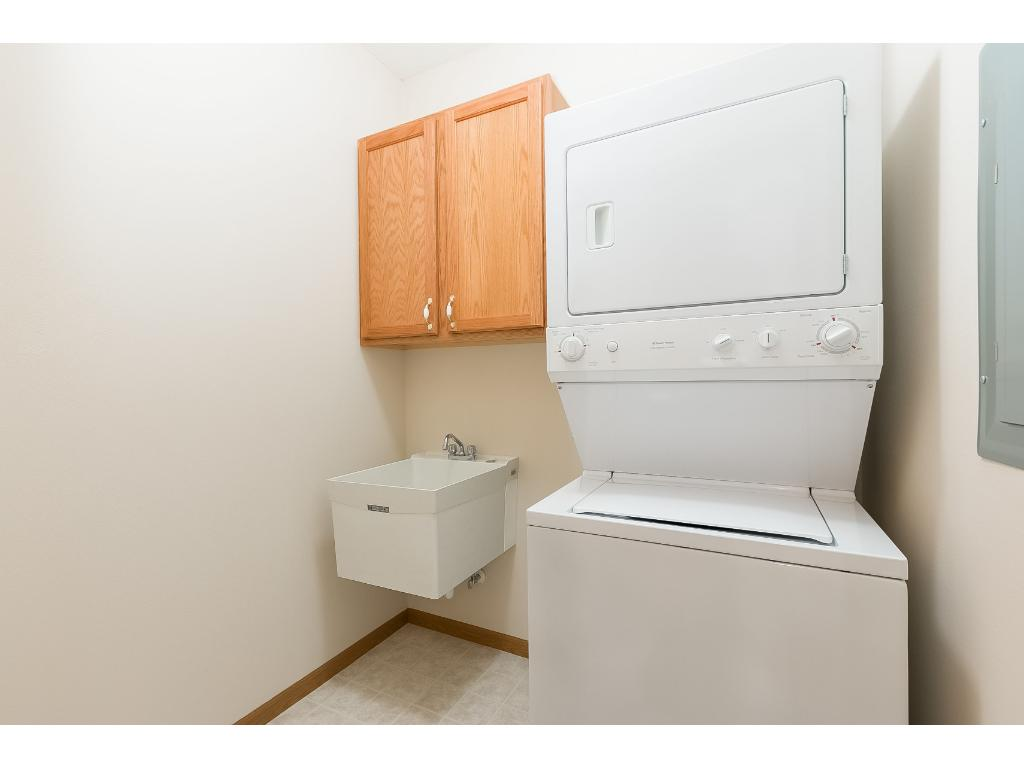Unit 309 has a full sized stacked washer and dryer along with a laundry sink. Extra storage over the sink.