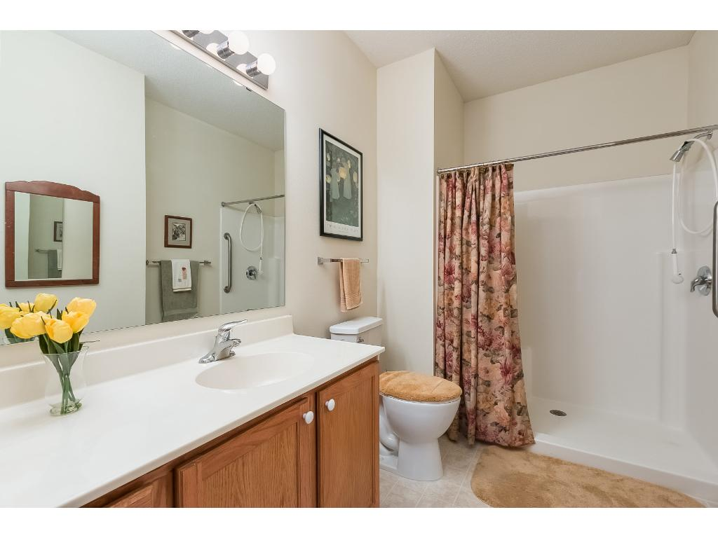Spacious master bathroom complete with a 5 foot walk-in shower and grab bars. Large linen cabinet and well lit mirror make this a great place to get ready for your day.