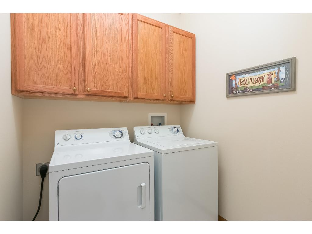 Private in-home laundry complete with full size washer and dryer and additional storage cabinets. Located just inside the front door.