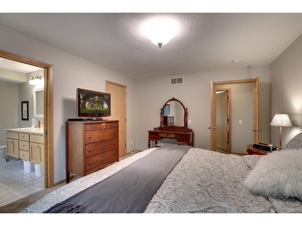 Enter through double doors into the owner's suite with private master bath and walk-in closet.