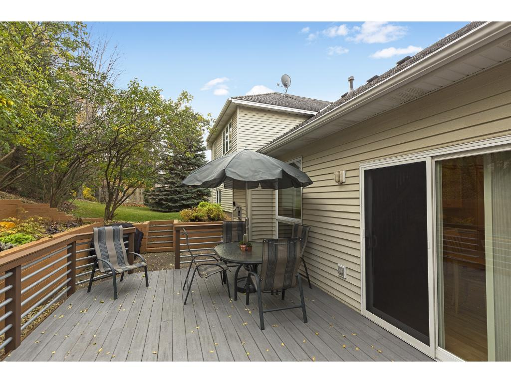 Enjoy dining alfresco on your private deck with extra space for grilling on the adjacent patio.