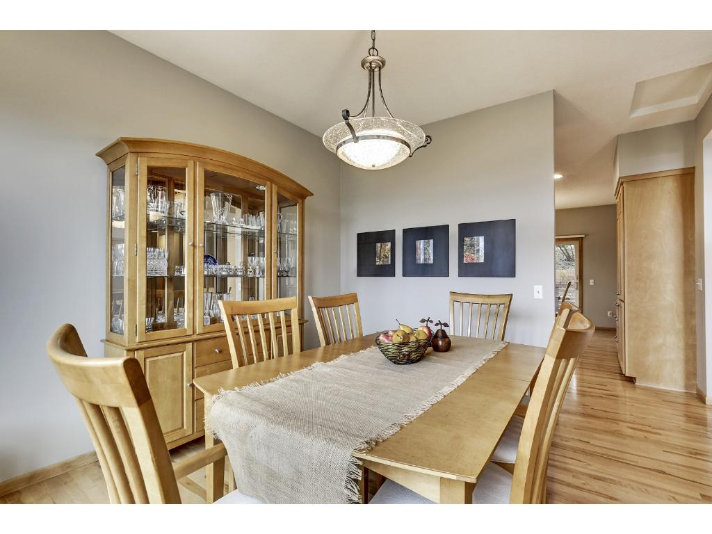Separate formal dining room with large window is adjacent to foyer and kitchen offering ease when serving your guests.
