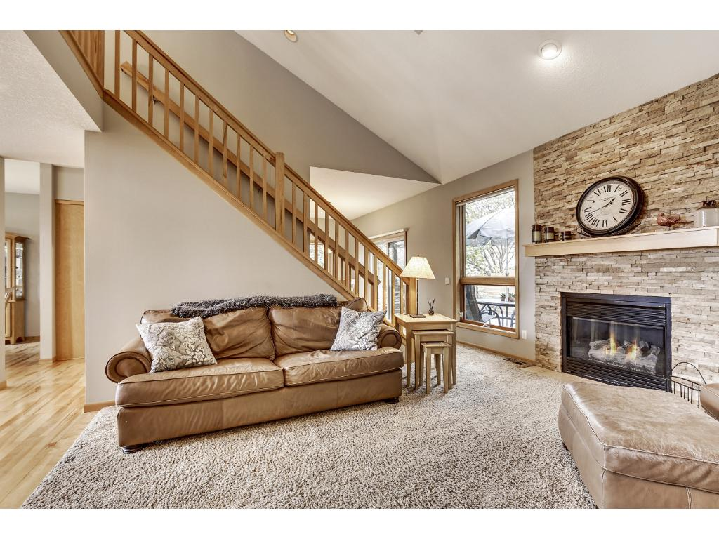 Relaxing great room boasts vaulted ceilings with gas burning fireplace dry stack stone surround, and over sized windows offering plenty of natural lighting. All windows updated to insulated clad.