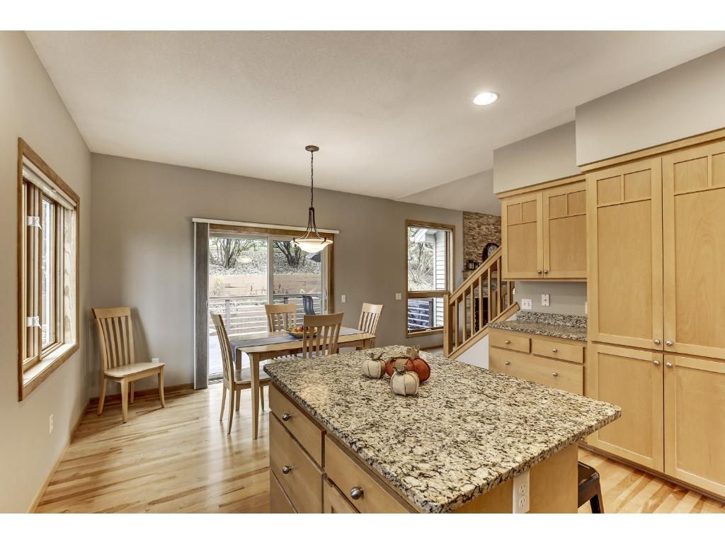 Informal dining area offers access via sliding glass door to a private maintenance free deck.