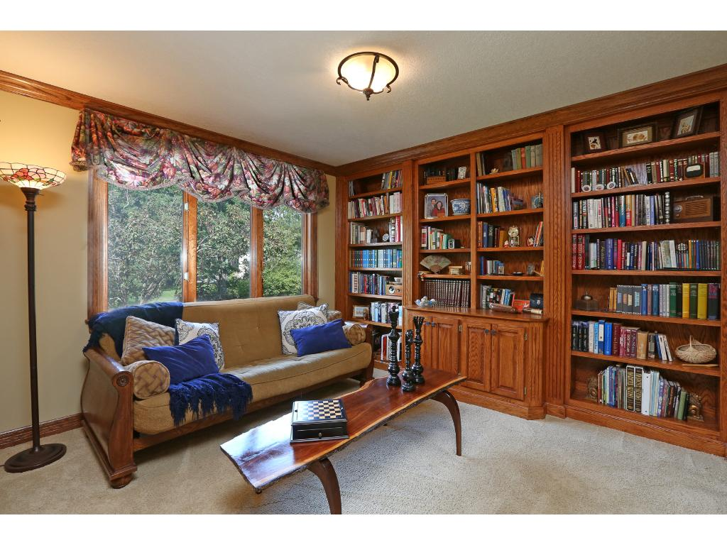 Main floor library with custom cabinetry