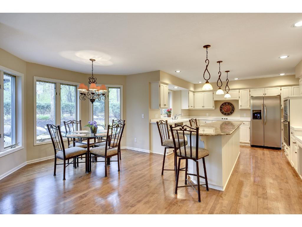 This view of the Kitchen captures the Informal Dining Area that overlooks the Backyard.