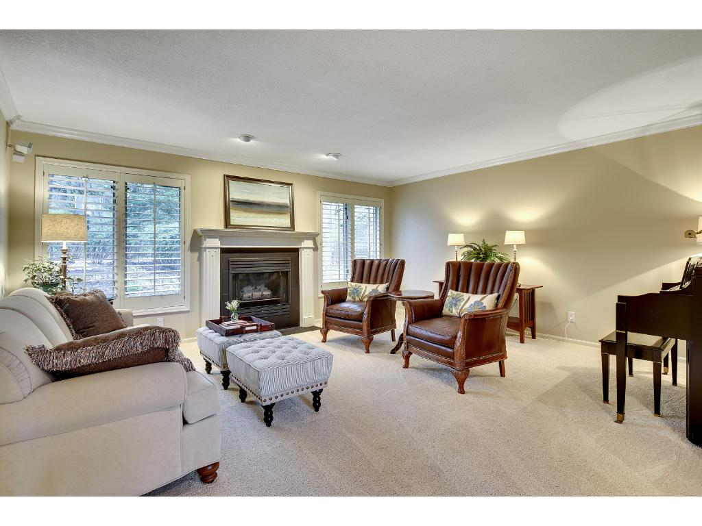 The Formal Living Room features a gas fireplace with a stately mantle!
