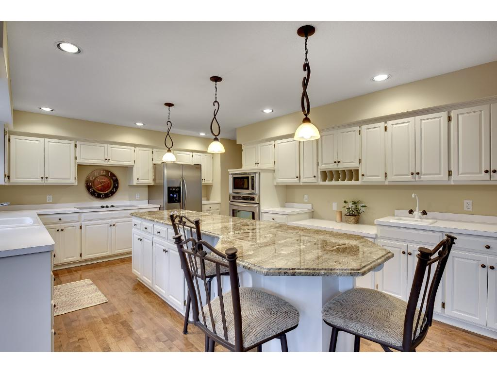 The Kitchen comes complete with lots of cabinets, stainless steel Frigidaire appliances, and a large granite center island. The Informal Dining Area is nestled nearby and overlooks the Backyard.