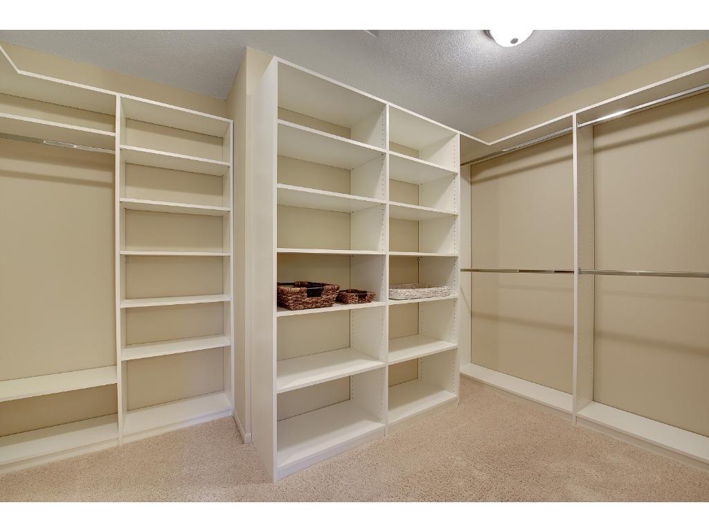 Master walk-in closet with new custom organizational storage system.