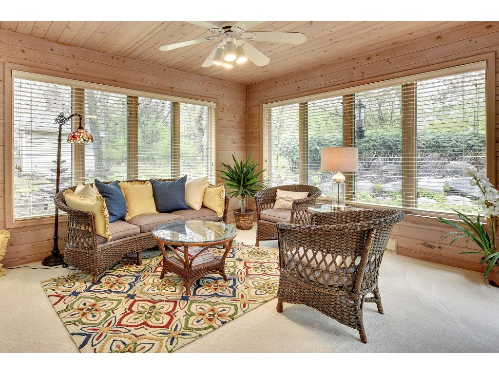 The cozy Sunroom leads out to the Deck as well, and looks out into the Backyard.
