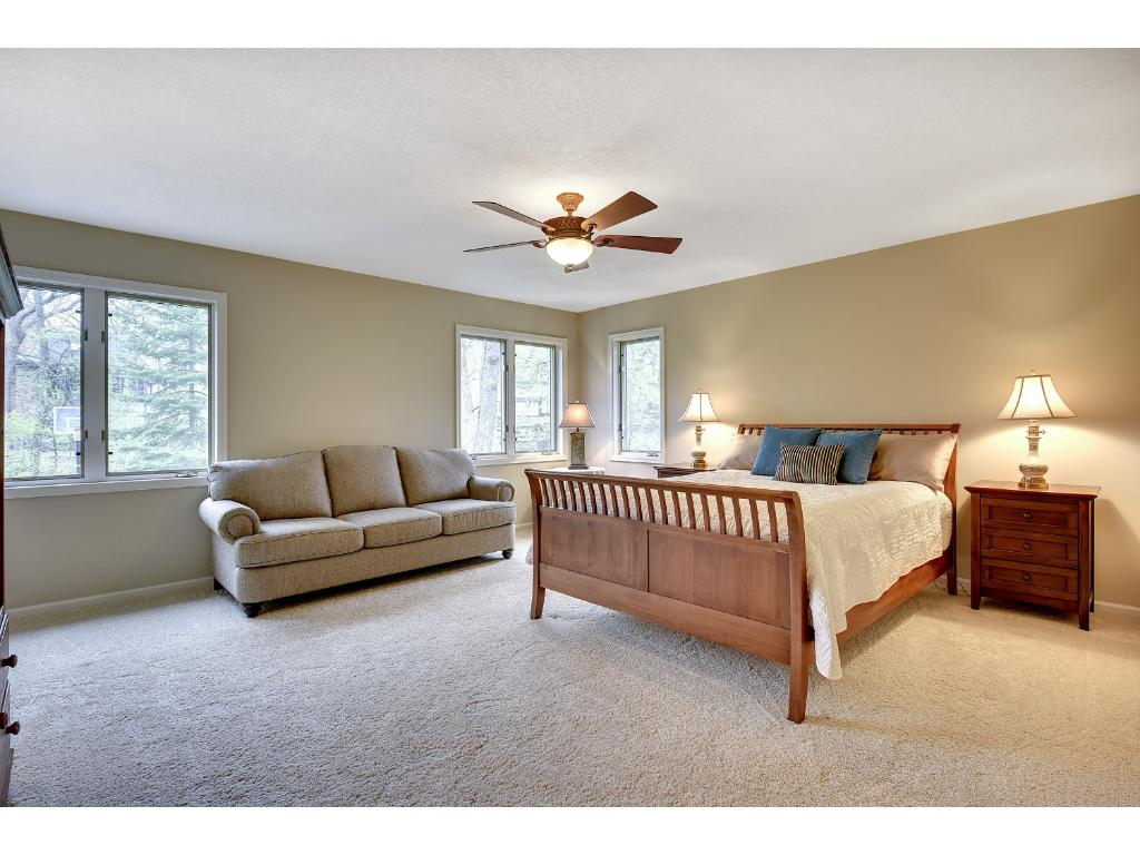 The spacious Master Suite features a large walk-in closet with a new custom organizational system and a private Bath.