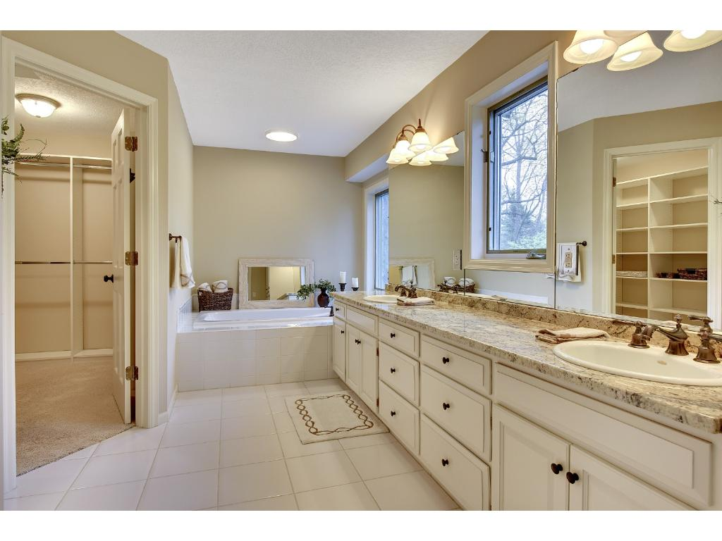 A dual sink vanity with granite countertop, whirlpool tub, large walk-in closet with a new custom organization system, and a separate shower/toilet room complete the Master Bath!