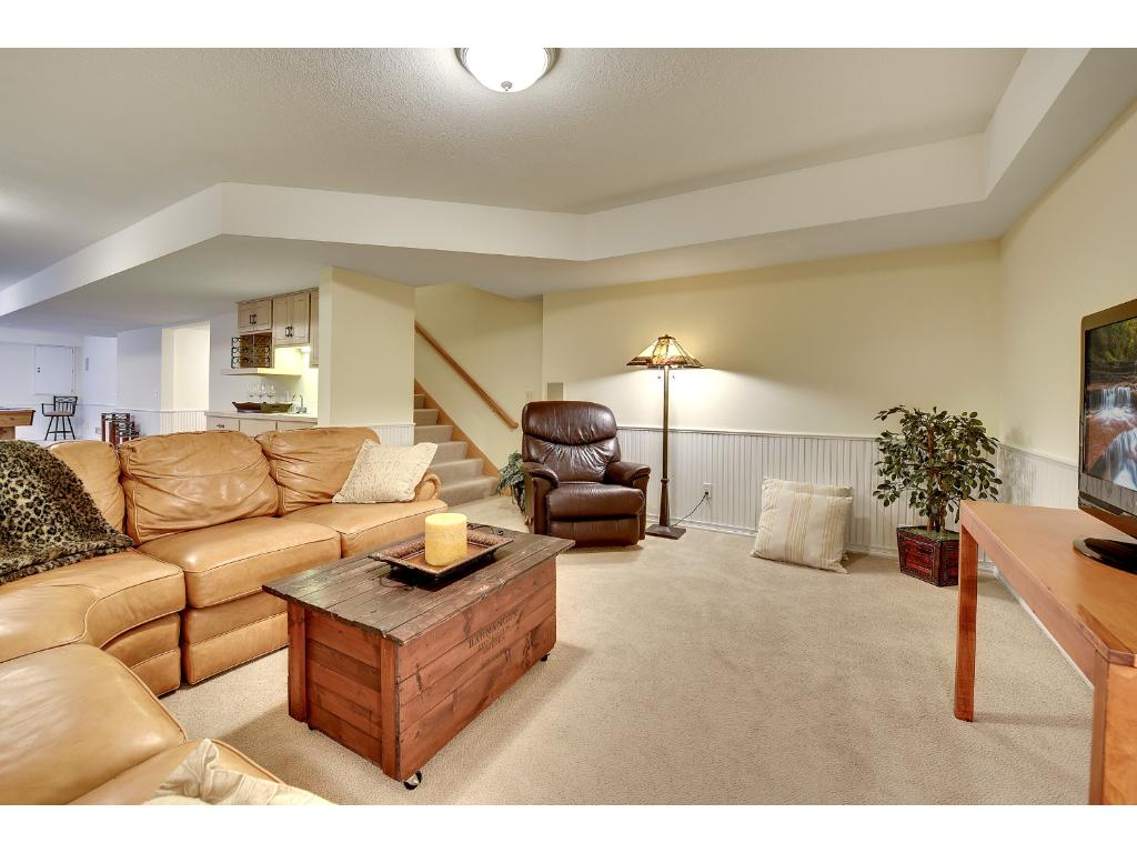 Lower level Family Room opens up to adjoining Wet Bar area.