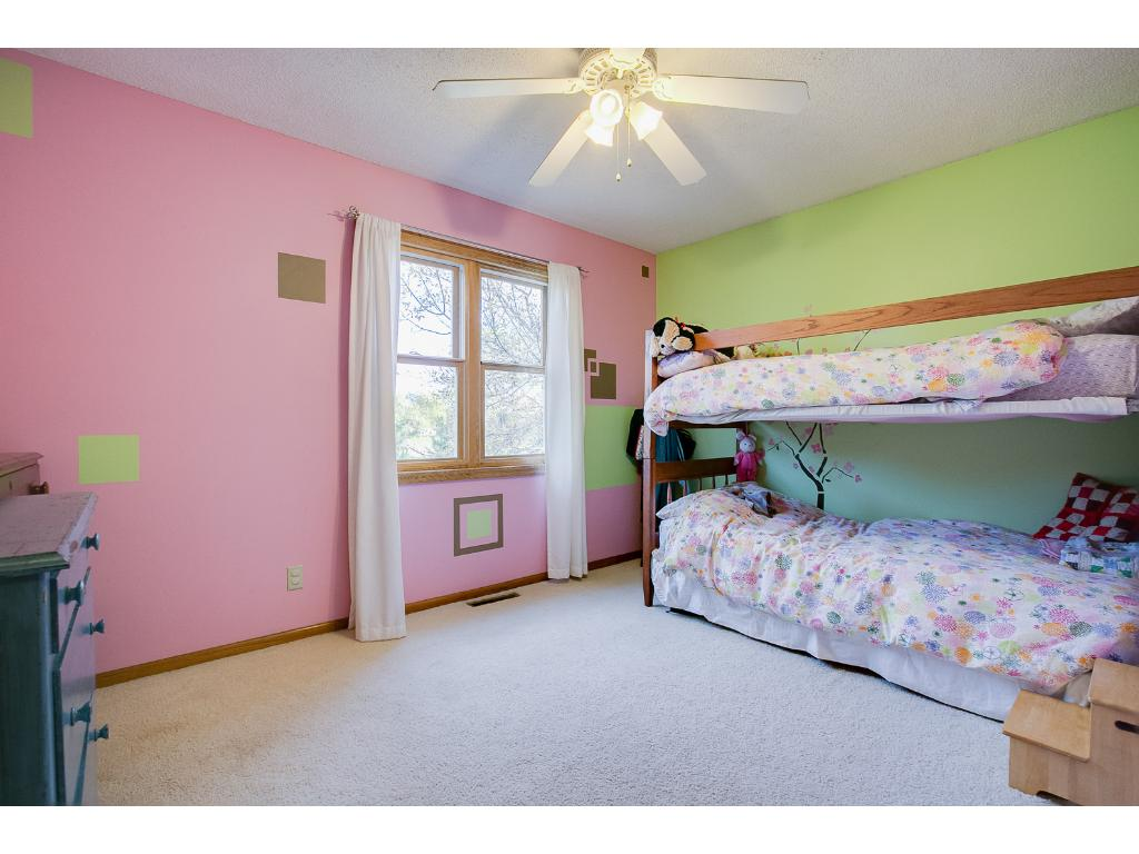Bedroom number two is plenty big and has a ceiling fan