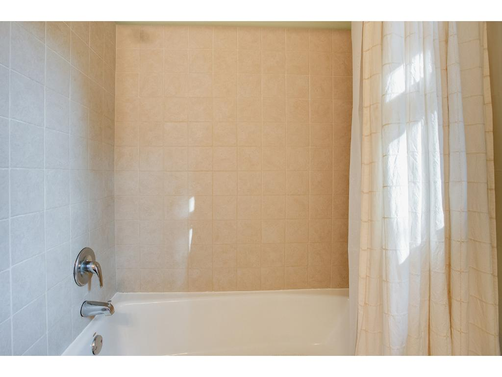 Updated bathroom showing the tiled shower